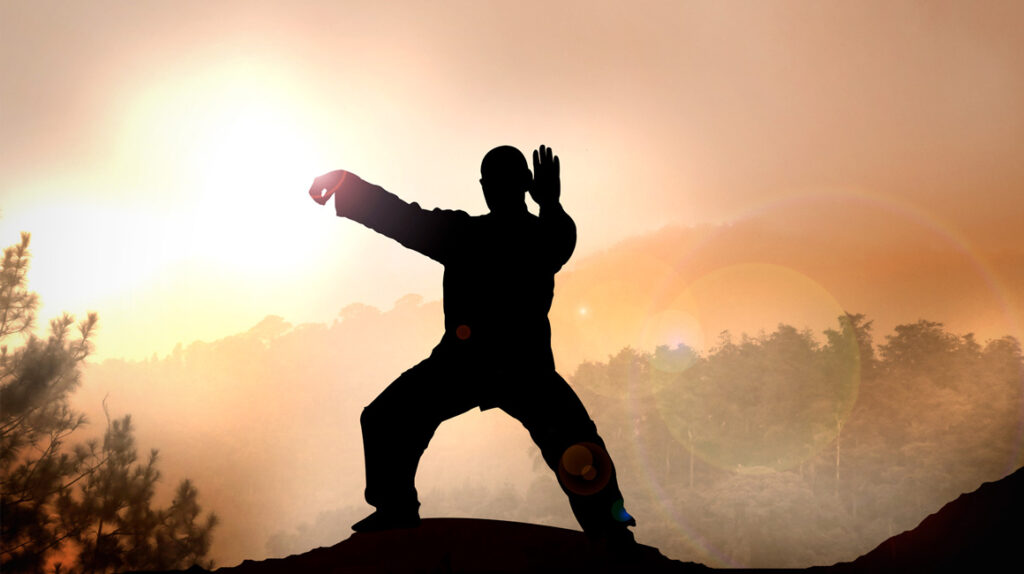 Man doing qigong and taiji exercise